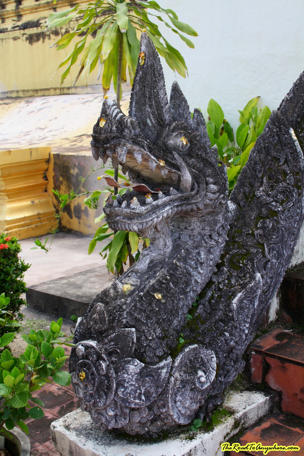 A naga (dragon) lines a stair case at Pha That Luang in Vientiane, Laos