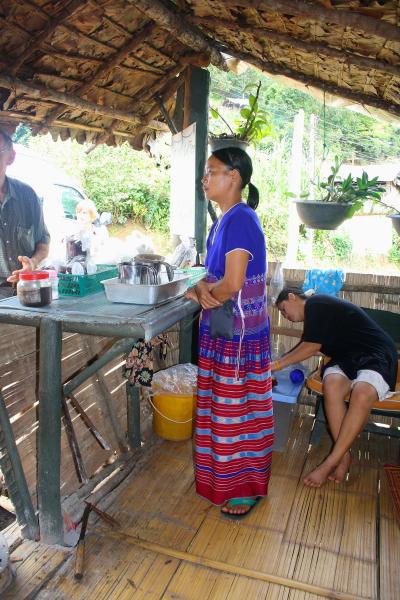 A Lady in  a White Karen village in Northern Thailand