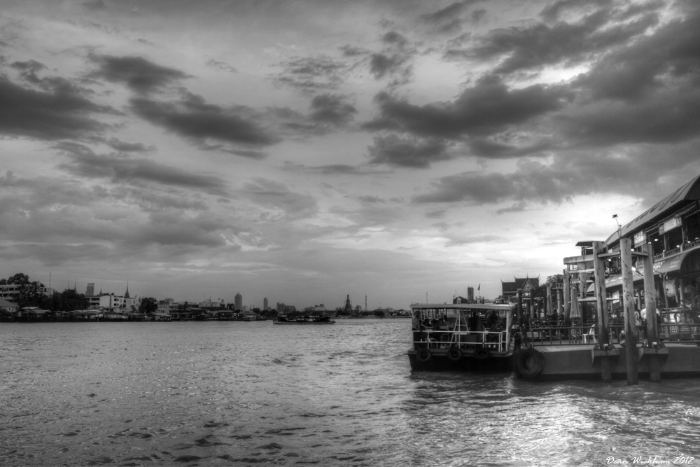 A Ferry at a pier on the Chao Phraya River in Bangkok, Thailand