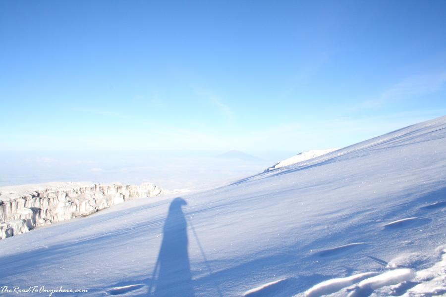 My shadow on the snow on the summit of Mount Kilimanjaro, Tanzania