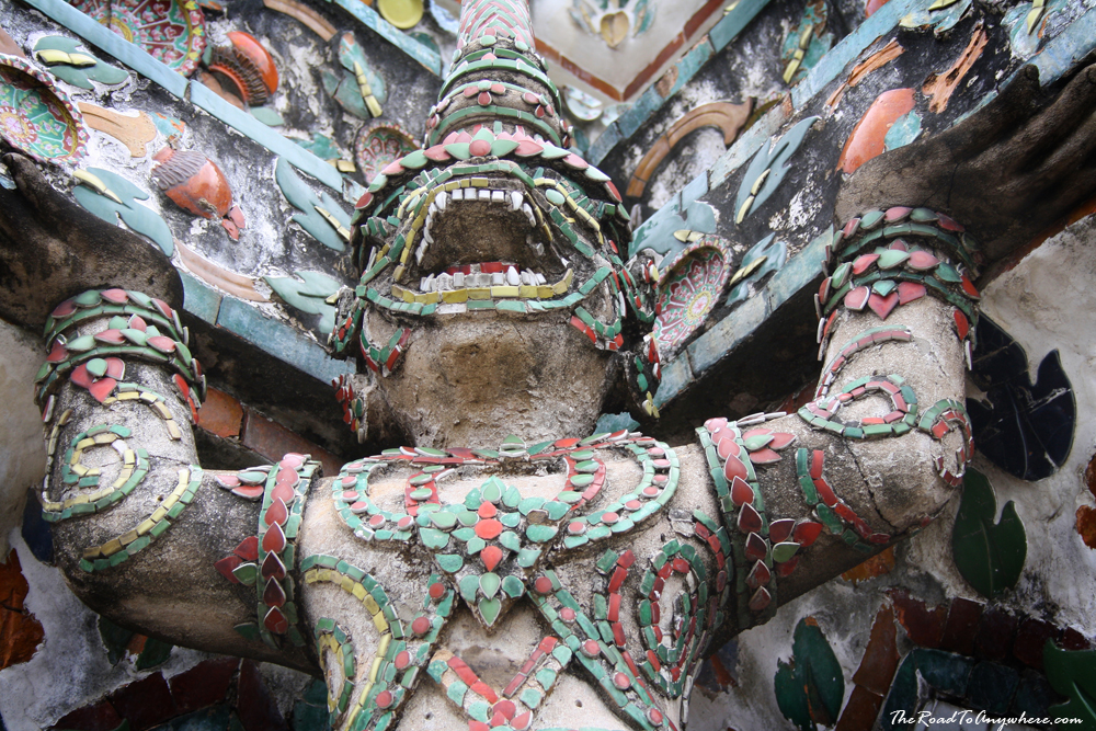 Demon statues hold up the temple at Wat Arun in Bangkok, Thailand
