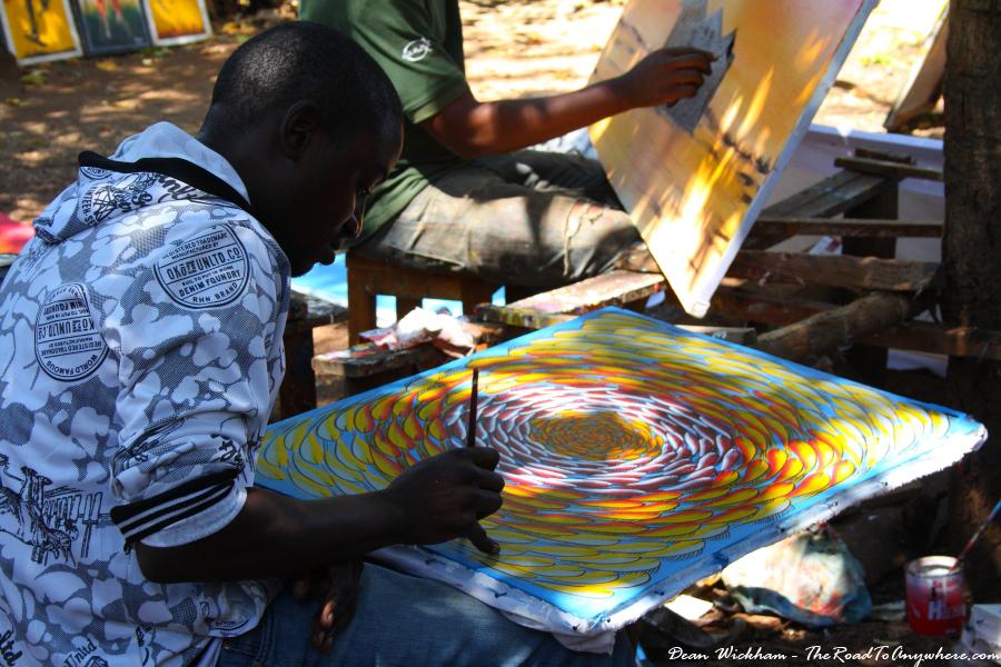 A tinga tinga artist at work in Mto wa Mbu, Tanzania