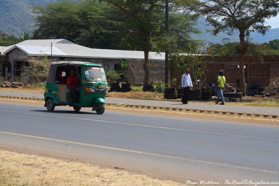 A tuk tuk on the main road in Mto wa Mbu, Tanzania