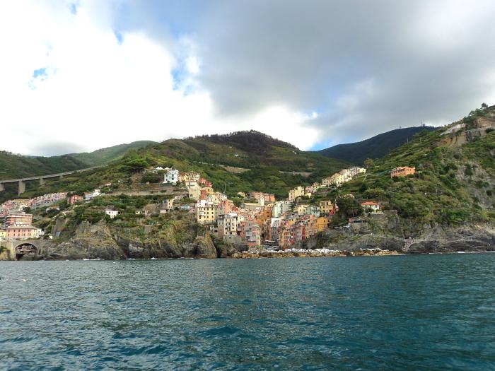 Riomaggiore from the sea Riomaggiore in Cinque Terre, Italy