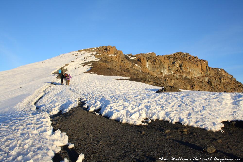 Walking through the snow to Uhuru Peak on Mount Kilimanjaro, Tanzania