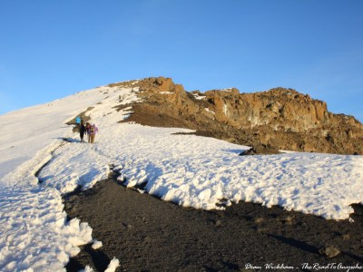 Walking through the snow to Uhuru Peak on Mount Kilimanjaro, Tanzania