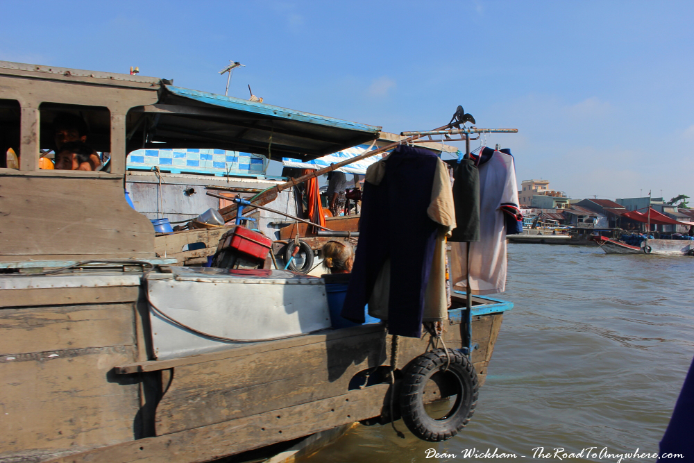 Laundry drying on a boat at Cai Rang Floating Market in the Mekong Delta, Vietnam