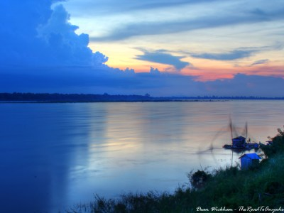 Locals fishing on the Mekong River at sunset in Kratie, Cambodia