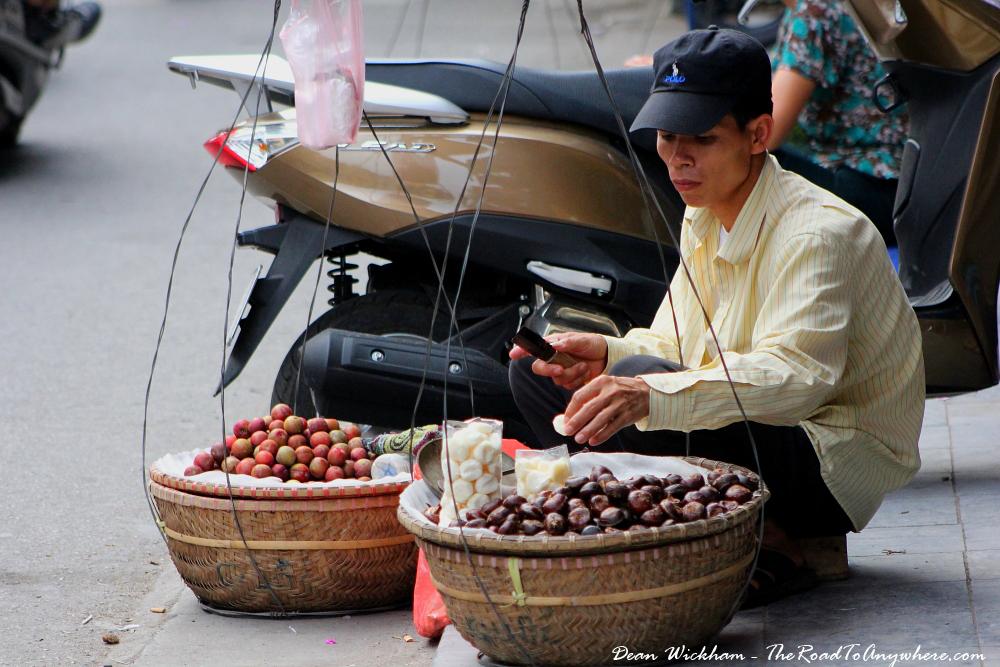 Man selling fruit on the street in Hanoi, Vietnam