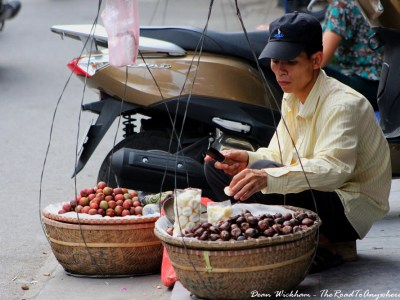 Man selling fruit on the street in Hanoi, Vietnam