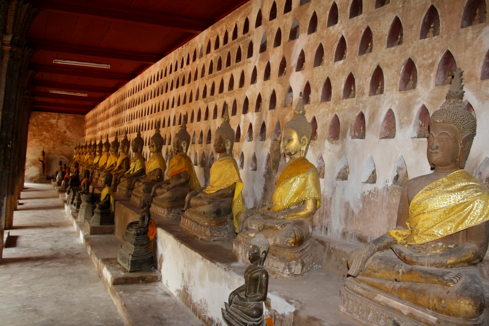 Buddhas line the walls of Wat Si Saket in Vientiane, Laos