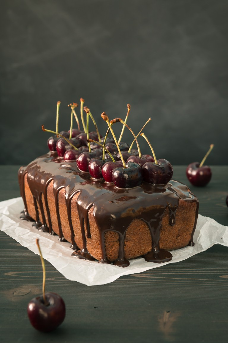 Chocolate Cherry Banana Bread - This elegant Chocolate Cherry Banana Bread is moist & delicious & sure to impress with juicy cherries, bits of chocolate, & a chocolate honey glaze.