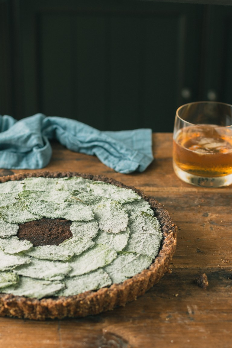 Chocolate Bourbon Pie with Candied Mint & a Brown Sugar Pecan Crust - This rich & decadent chocolate bourbon pie with mint & a brown sugar pecan crust & candied mint leaves is a mashup between a mint julep & a derby pie.