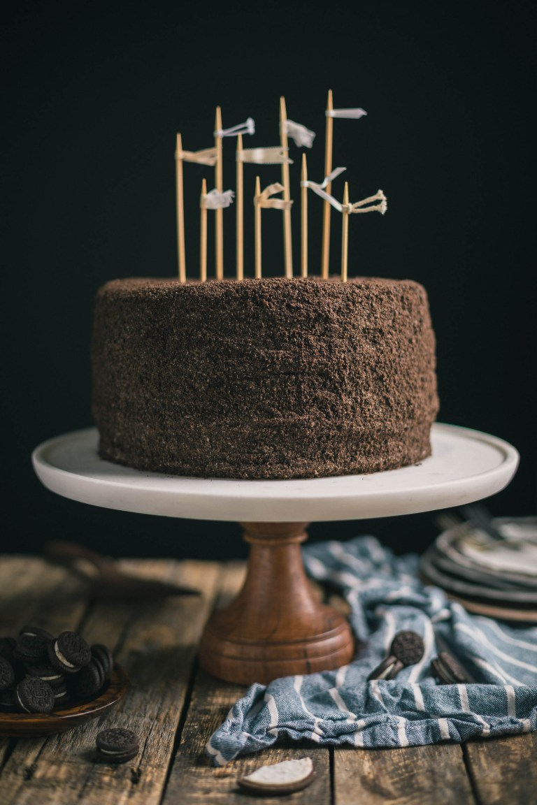 This Brown Butter Pumpkin & Chocolate Oreo Layer Cake is a moist chocolate layer sandwiched between two layers of brown butter pumpkin cake dotted with flecks of Oreo.  The cake is then topped with a rich brown butter cream cheese frosting & then coated with Oreo cookie crumbs.