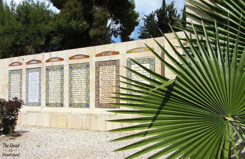 A row displaying the Lord's prayer in different languages set in the grounds