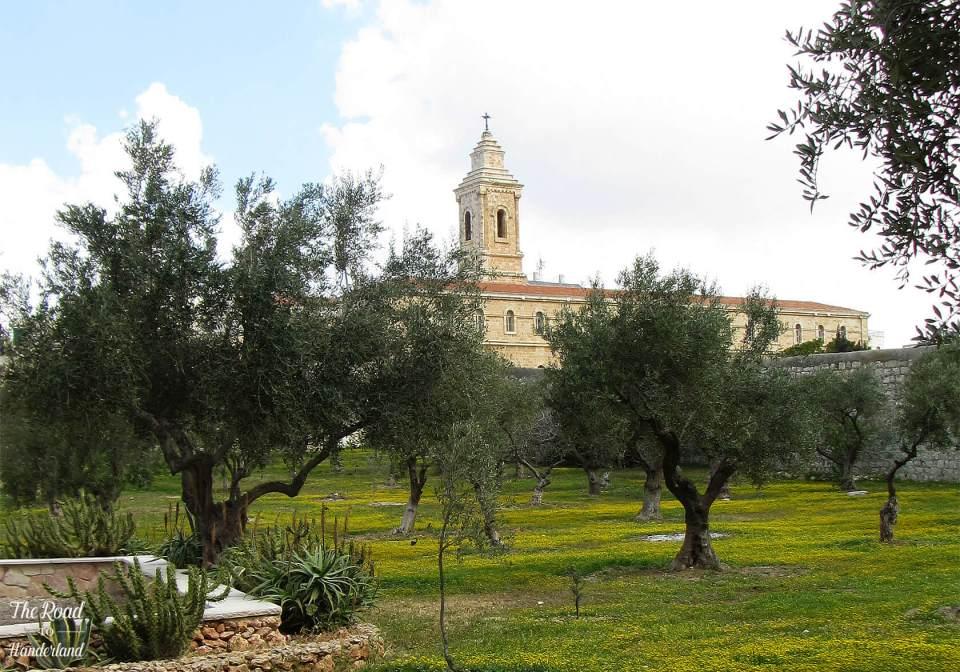 Church of the Pater Noster behind a field of olive trees