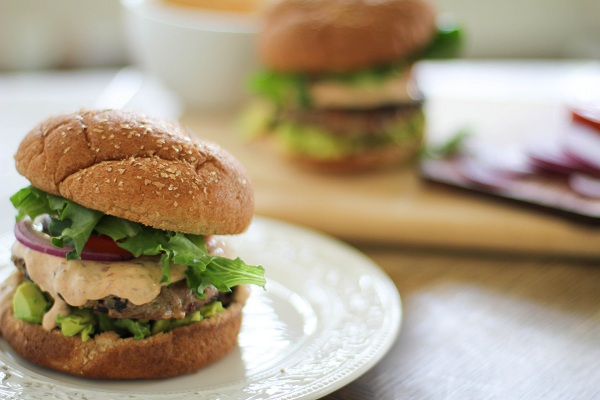 Southwest Turkey Burgers with Chipotle Yogurt Sauce | http://www.theroastedroot.net