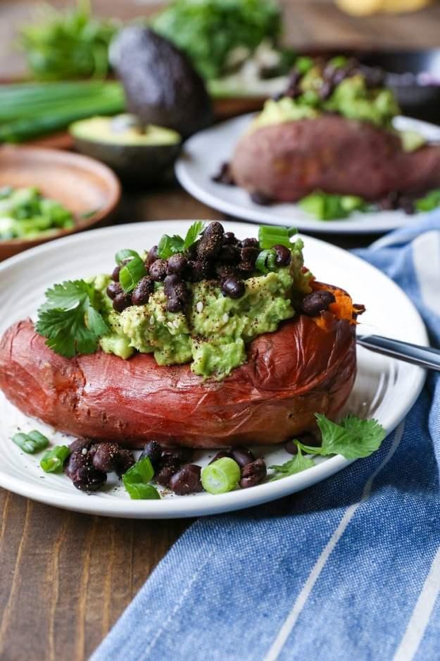 Guacamole and Black Bean Loaded Sweet Potatoes | TheRoastedRoot.net #healthy #glutenfree #recipe #vegan #vegetarian