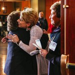 Women hugging greeting welcome