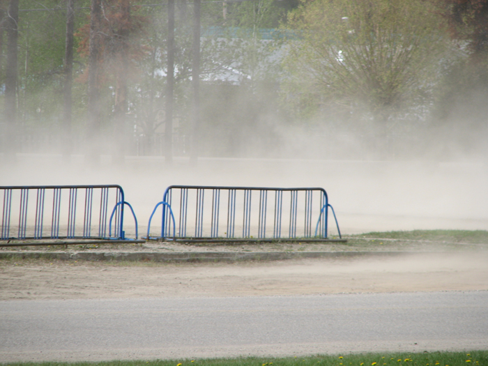 Dusted out: Neighbours protest over school lot dust storms