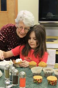 cupcake, icing, family, volunteer, dessert, decorating, helping, help