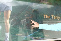 Mt Terry Fox Trail Logging- Patricia Thoni points to the trail on a sign at the Terry Fox pull-out on Hwy 5 (3)