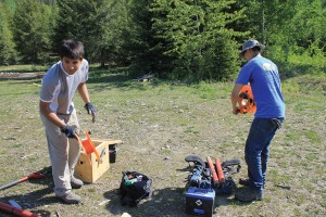 Students working with Professor Martyn Unsworth pack up the probes, wires and battery to move them to a nearby site for more testing.