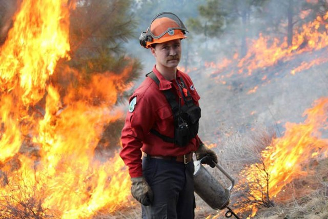 Photo courtesy BC Gov  - A provincial firefighter doing a controlled burn.