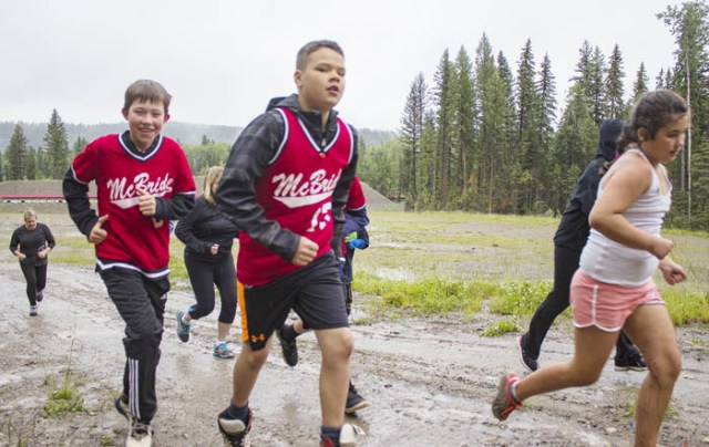 Photo: Evan Matthews The McBride kids continue through the 5.7 km course.