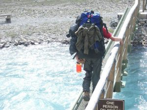 Supplied: A student crosses one of the many bridges on the way to Berg Lake.