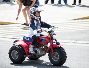 The kids stole the show at this year's Valemountain Days parade, some of whom were even driving through the downtown on motor vehicles. Who knew a trike could be so cute? / BOB HOSKINS