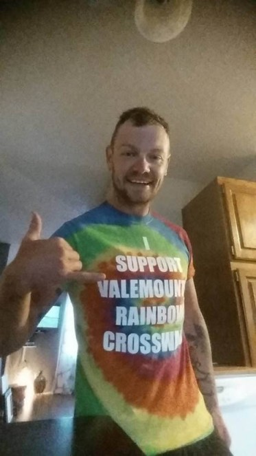 Photo: Supplied Fast Eddy sports his new shirt in support of Valemount's Rainbow Crosswalk, which provoked a passenger of a passing truck to yell a homophobic slur.