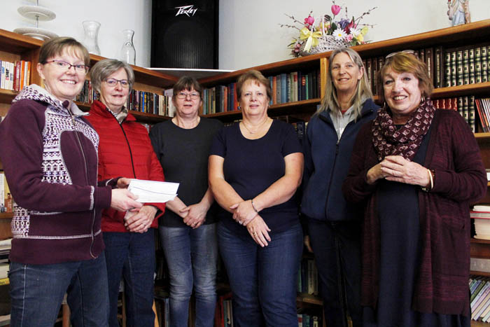 """Photo: Evan Matthews Left to right: Donna Duerkson, Linda Hedberg, Silvia Cuddeback, Lidwina Flavelle, Sandy Braun and Marion Farquharson. Donna Duerkson from the Valemount Quilting Society presents cheques to Marion Farquharson from the Valemount Senior Housing Society. VCTV won $1,000 at the local cable awards this past summer, and donated the funds to the quilting society in a random draw. After deciding the funds could be better used within the Senior Housing Society, the Quilting Society decided to re-donate and topped it up with $500 of their own money. The $1500 was split evenly between the Seniors Housing Society and Meals on Wheels (a Housing Society program) """"We use the facility downstairs, and (the Senior Housing Society) has never upped the rent,"""" says Duerkson. """"They've been really good to us. To me, this is where the money needs to go, and we'll be here one day too."""""""