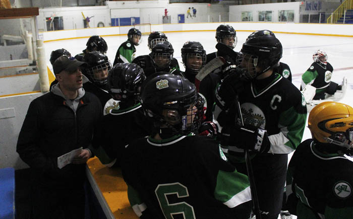 The Edmonton team gets a pep talk from their coach prior to the championship.