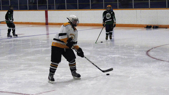 """Ryan McNee takes a shot on the """"shooter-tutor"""", as he showcases his accuracy during the skills competition."""