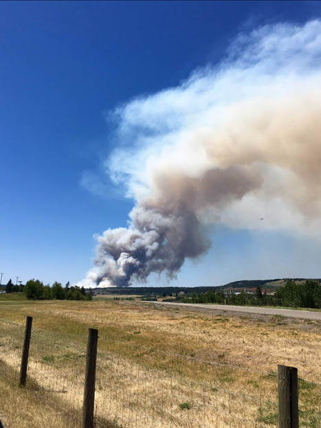 Fires rage on; evacuee numbers climb