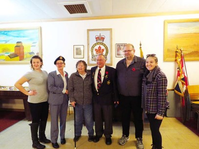 Bob Balcaen (centre) stands with wife Hazel, flanked by daughter Corrine and son Lee, granddaughters Natasha (L) and Charlotte (R) Dickerson, after a small ceremony honour- ing him for 50 years of service with the Legion in McBride. This week also marks the 50 year anniversary of his discharge from the Air Force. /ANDREA ARNOLD