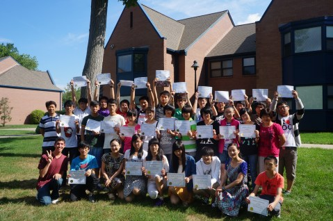 Chinese Students Display Their Certificates