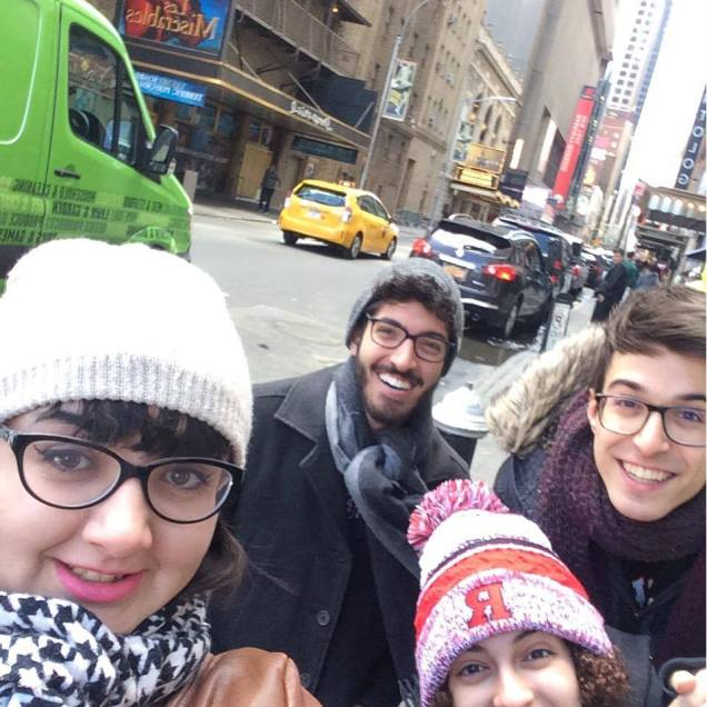 Task: Take a picture with a Broadway show billboard.