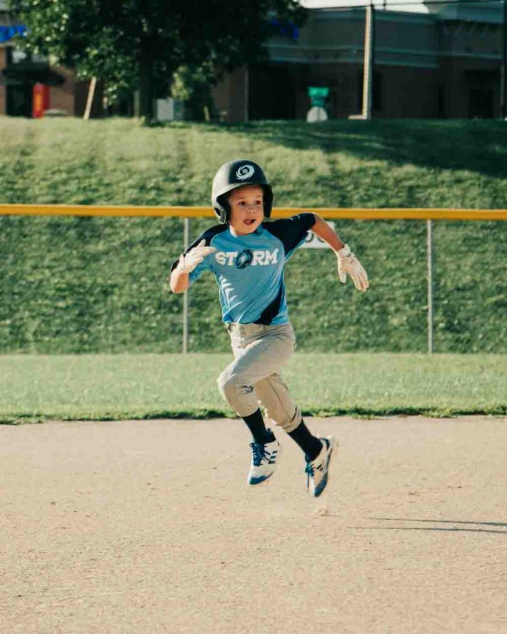 Player Running Bases in Little League