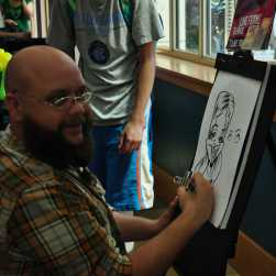 The caricature artist gets away with making fun of students' features slyly