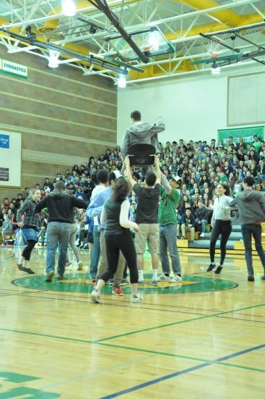 The Jewish Culture Club hoists a member up in the air during their performance