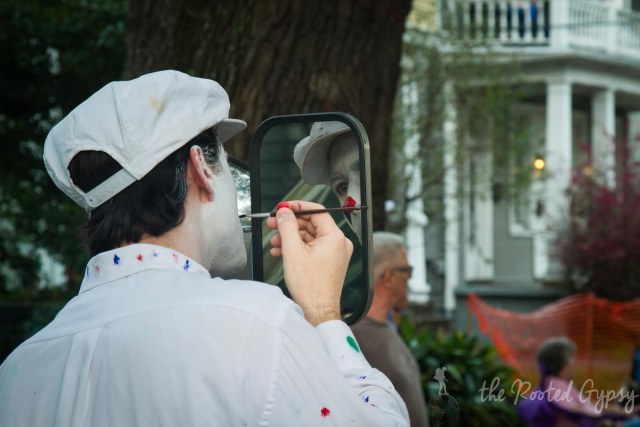 Clown applying makeup for Mardi Gras Parade New Orleans