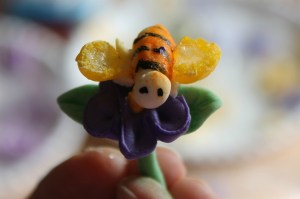 Gum paste bee on a royal icing flower.