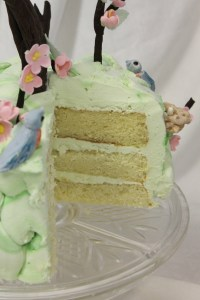 Apple blossom cake cut vertical