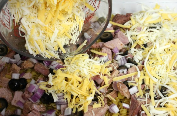 Add olives and onions and smother with cheese.