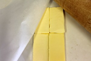 Cut each stick of butter into four slices. Roll between waxed paper to proper size.