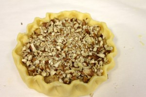 Press chopped pecans firmly on top.