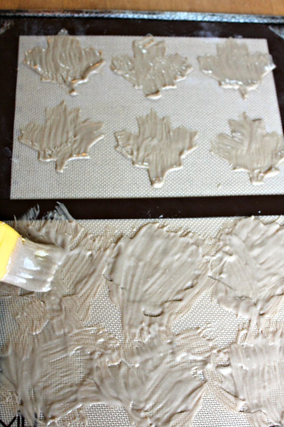 Brushing brown leaves on the stencils