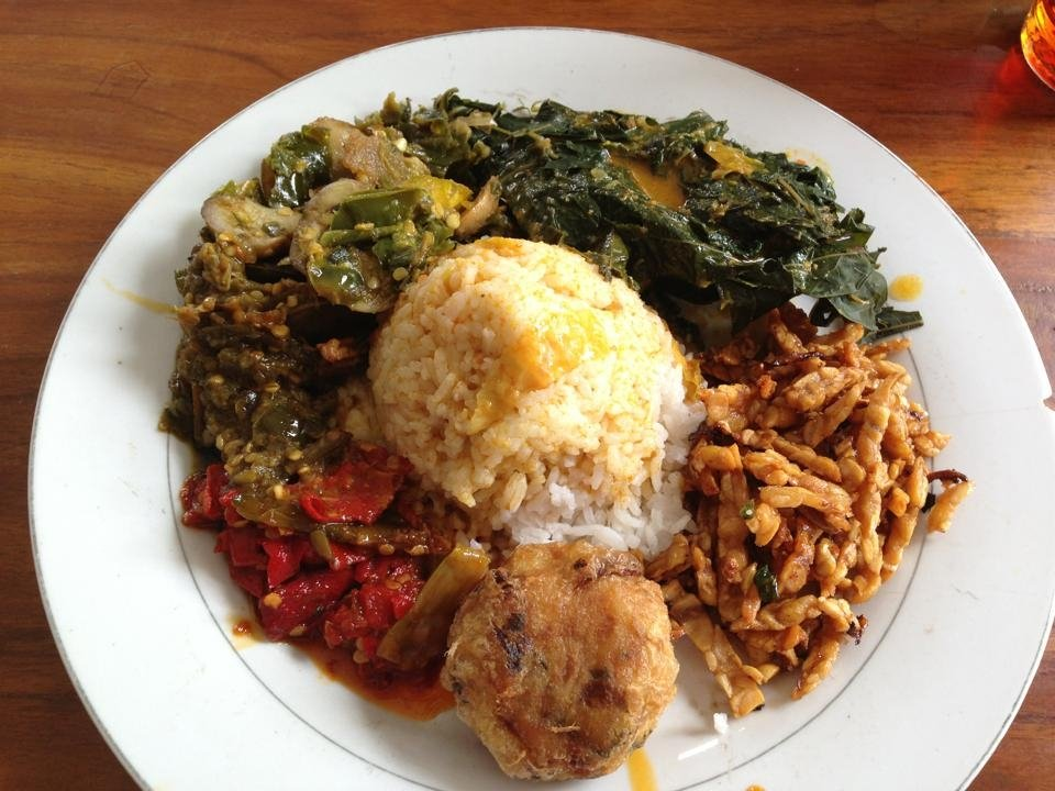 Typical Indonesina food, a dish with rice, meat, greens, and sambal sauce